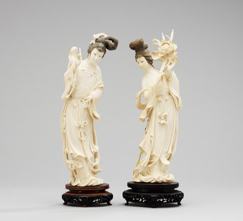 A pair of 20th Century Chines ivory figures. Height 34 cm.