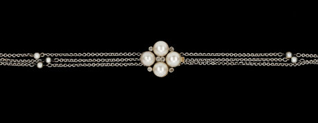 Necklace, three rows with small pearls and clasp with small diamonds and cultured pearls.