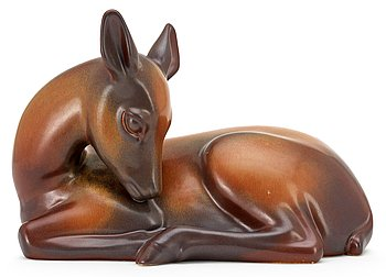 A Gunnar Nylund stoneware figure of a deer, Rörstrand. Height 19,5 cm, length 29 cm.