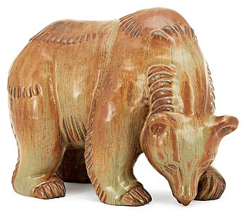 A Gunnar Nylund stoneware figure of a bear, Rörstrand. Height 23 cm, length 28 cm.