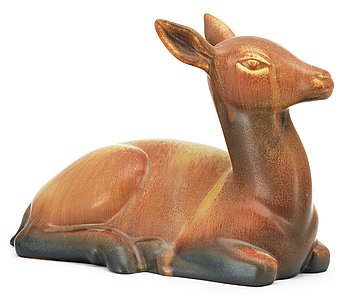 A Gunnar Nylund stoneware figure of a deer, Rörstrand. Height 19 cm, length 27 cm.