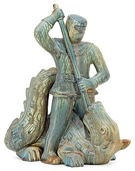 A Gunnar Nylund stoneware sculpture of S:t Michael and the dragon, Rörstrand. Height 32,5 cm, length 26 cm.
