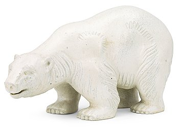 A Gunnar Nylund stoneware figure of a polar bear, Rörstrand. Height 21 cm, length 39 cm.