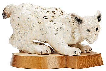 A Gunnar Nylund stoneware figure of a lynx, Rörstrand. Height 18 cm, length 34 cm.