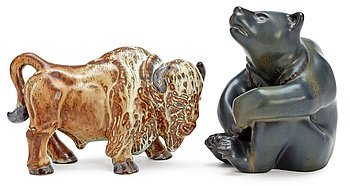 313. Two Gunnar Nylund stoneware figures, a bear and a bison, Rörstrand.