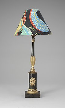 An Empire gilt och patinated bronze table lamp.
