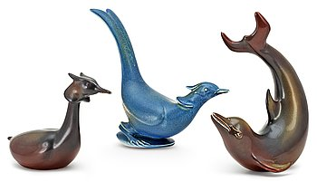 Three Gunnar Nylund stoneware figures, a dolphin, a pheasant and a great crested grebe, Rörstrand. Height 16-22,5 cm.