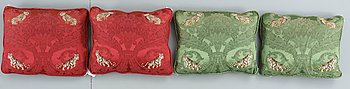 CUSHIONS, 4. Probably France, second half of the 20th century. Ca 45 x 56 cm each. Two green and two red with polychrome lepards and tigers.
