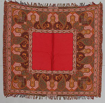 SHAWL. Patrick Frey, Paris, second half of the 20th century. 141 x 139,5 cm. Red field. Broad polychrome border with a large boteh-(pai...
