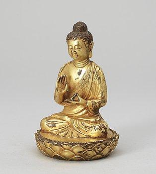 52. A gilt bronze Buddha, late Qing dynasty.