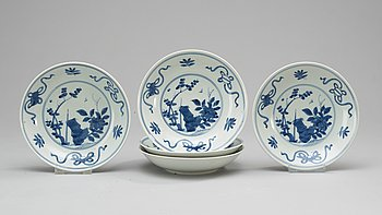 76. A set of five blue and white 19th Century Japanese bowls.