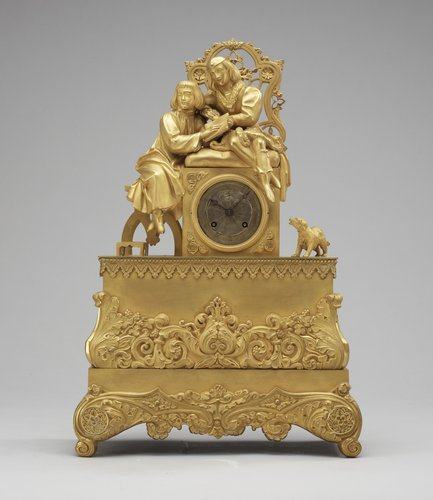 A french neo-gothic circa 1830 gilt bronze mantel clock.