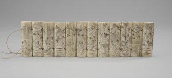 82. Twelve Chinese bone panels, 20th century.