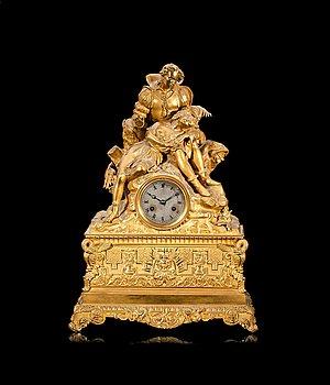 94. A French 1830/40's gilt bronze mantel clock.