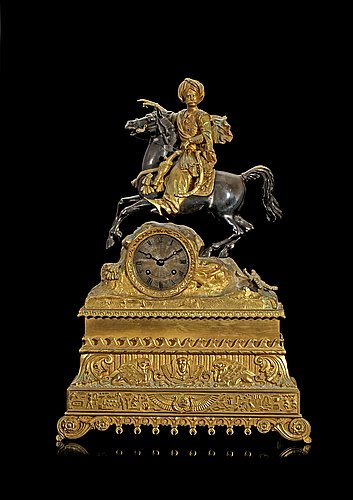 A french 1830/40's gilt and silvered bronze and brass mantel clock.