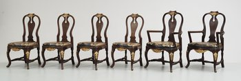 96. A set of 12 rococostyle chairs, 20 th century.