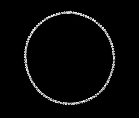 A brilliant cut diamond necklace, tot. 21.47 cts.