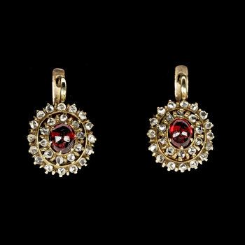 1005. EARRINGS, cabochon cut rubies and rose cut diamonds. Russian, 1900.