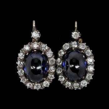 1003. EARRINGS, antique cut diamonds, tot. app. 2.50 cts, set with blue glass stones.