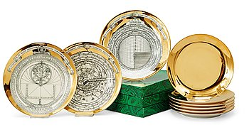 11. A set of three Piero Fornasetti 'Astro Labio' porcelain plates and six gilded dishes, Milan, Italy.