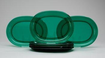 231. A set of six Josef Frank green glass dinner plates.