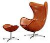 An arne jacobsen brown leather 'egg' chair and ottoman, fritz hansen, denmark 1963.