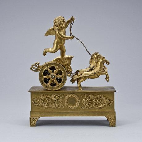 An 19th century empire style bronze clock.