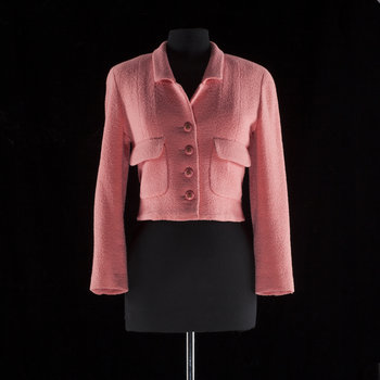 1206. A pink bouclé jacket by Chanel.