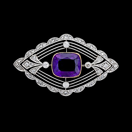 An amethyst and diamond brooch, c. 1905.