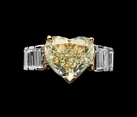 A heart cut fancy light yellow diamond ring, 3.75 cts.