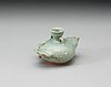 A celadon glazed water-dropper/water pot, yuan dynasty (1271-1368).