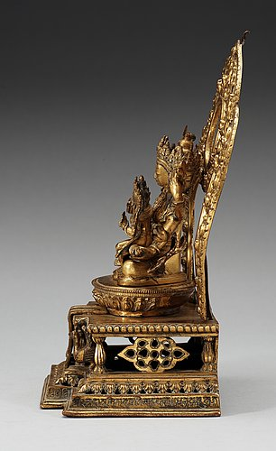 A large gilt bronze nepal/sino-tibetan figure of buddha, qing dynasty, presumably qianlong (1736-95). with an inscription around the base.