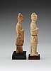Two glazed pottery figurines of standing officials, with traces of paint, tang dynasty (618-907).