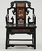 A black and red lacquered wooden chair, qing dynasty.