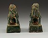 A pair of green glazed figures of 'buddhist lions', ming dynasty.