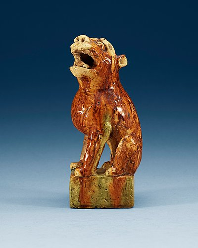 A potted figure of a 'buddhist lion', tang dynasty (618-907).