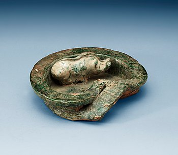 1604. A green glazed heart shaped pigsty with pig, Han dynasty (206 BC- 220 AD).