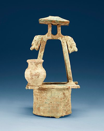 A green glazed pottery model of a well, han dynasty (206b.c-220).