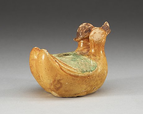 A yellow and green glazed figurine of two mandarin ducks. ming dynasty ( 1368-1644).