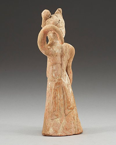 A potted figure of a dancer, tang dynasty (618-907).