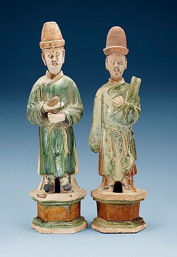 Two green and yellow glazed potted figures of dignitaries, ming dynasty.