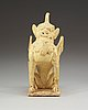 A yellow glazed pottery guardian, tang dynasty (618-907).