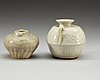 A set of two white glazed small urns, yuan (1271-1368) and ming dynasty (1368-1644).