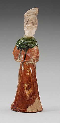 A green and yellow glazed figure of a standing lady, tang dynasty.
