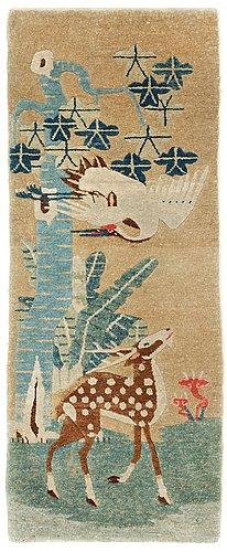 A semi-antique chinese figural rug.