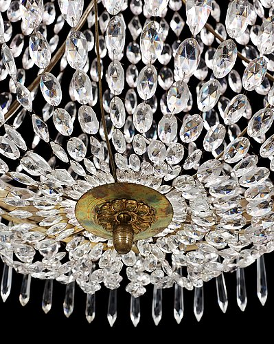 A swedish empire seven-light chandelier.