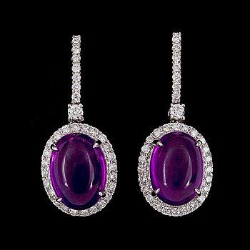 2. EARRINGS, cabochon cut amethysts and brilliant cut diamonds, tot. 0.75 cts.