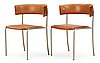 A pair of erik karlström steel and brown leather chairs, stockholm ca 1965.