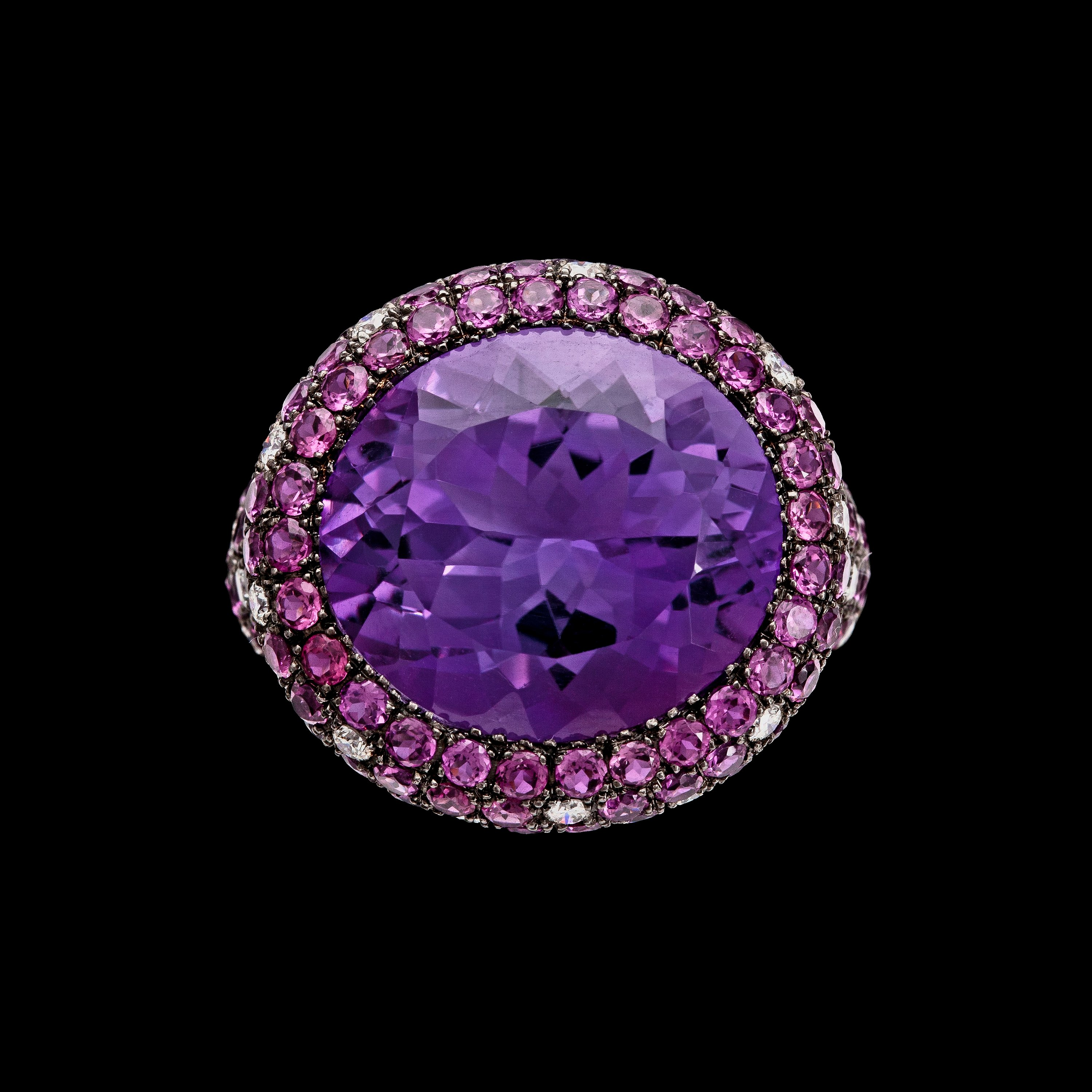An amethyst, app 5 20 cts, pink sapphire and diamond ring