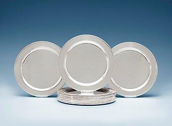 504. A set of sixteen Sigvard Bernadotte silver plates, Georg Jensen, Copenhagen 1945-77.